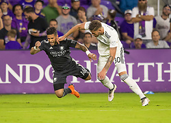 April 21, 2018 - Orlando, FL, U.S. - ORLANDO, FL - APRIL 21: Orlando City forward Dom Dwyer (14) gets fouled during the MLS soccer match between the Orlando City FC and the San Jose Earthquakes at Orlando City SC on April 21, 2018 at Orlando City Stadium in Orlando, FL. (Photo by Andrew Bershaw/Icon Sportswire) (Credit Image: © Andrew Bershaw/Icon SMI via ZUMA Press)