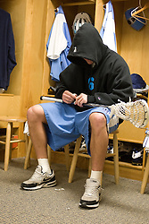 08 March 2008: North Carolina Tar Heels men's lacrosse midfielder Fletcher Gregory (6) puts tape on his stick pregame before playing the Notre Dame Fighting Irish in Chapel Hill, NC.