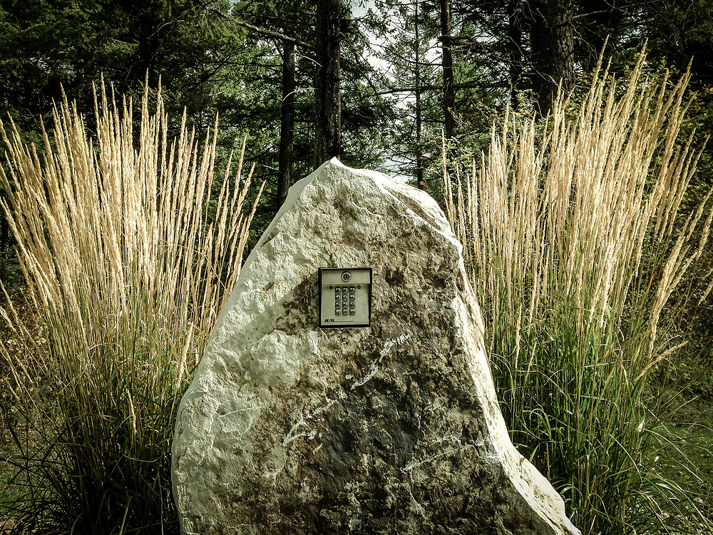 Security keypad in a boulder at a gated community