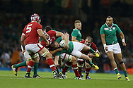 Keith Earls  of Ireland is hauled down by Andrew Tiedemann of Canada.Rugby World Cup 2015 pool match, Ireland v Canada at the Millennium Stadium in Cardiff, South Wales  on Saturday 19th September 2015.<br /> pic by  Andrew Orchard, Andrew Orchard sports photography.