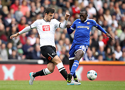 George Thorne of Derby County and Toumani Diagouraga of Brentford challenge for possession - Mandatory byline: Robbie Stephenson/JMP - 07966 386802 - 03/10/2015 - FOOTBALL - iPro Stadium - Derby, England - Derby County v Brentford - Sky Bet Championship