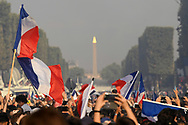 French flags during the parade of the team France on Champ-Elysées after winning the 2018 FIFA World Cup Russia on July 16, 2018 in Paris, France - Photo Philippe Millereau / KMSP / ProSportsImages / DPPI