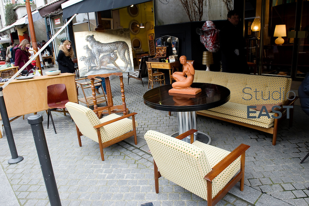 PARIS, FRANCE - FEBRUARY 08: A furniture suite in Saint-Ouen flea market, on February 8, 2014, outside Paris, France. The Paris Flea Market (Le Marche aux Puces) opened in 1885. Located in a popular district, it extends over six hectares in Saint-Ouen, a city near Paris. The Paris Flea Market is a famous Paris shopping venue attracting 70 000 shoppers every week. (Photo by Lucas Schifres/Getty Images)