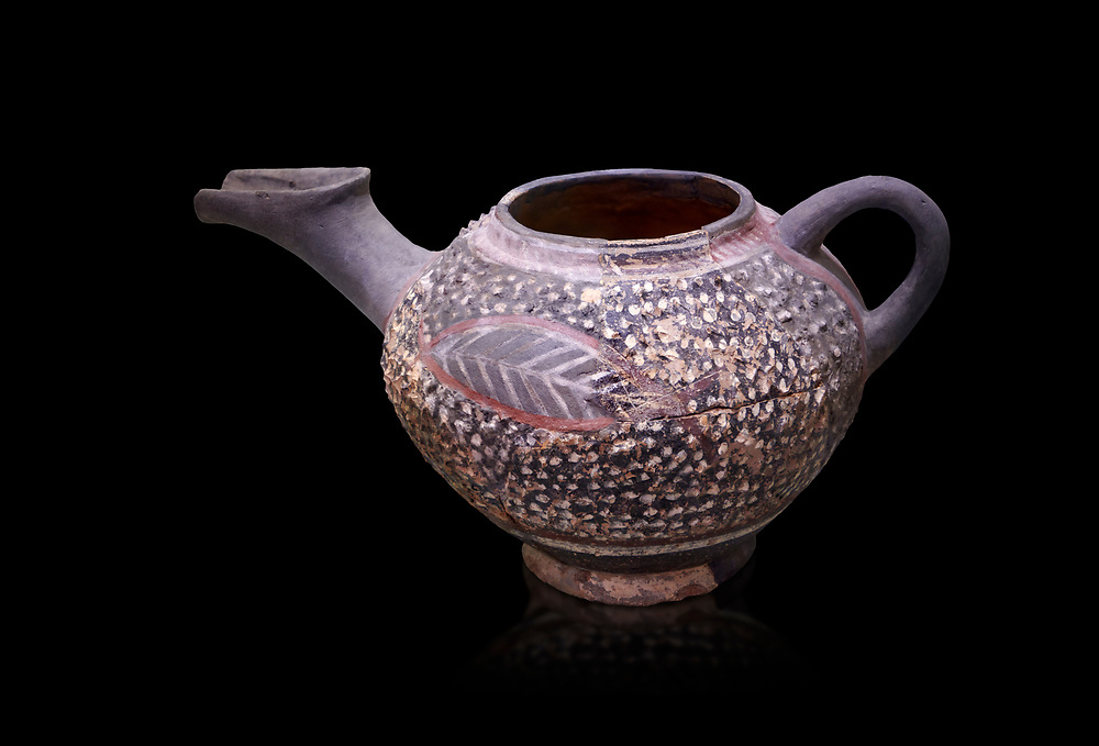 """Minoan Kamares Ware beak spouted """"teapot"""" with extended spout and  leaf polychrome decorations, Kamares Sacred Cave 1900-1700 BC; Heraklion Archaeological  Museum, black background.<br /> <br /> This style of pottery is named afetr Kamares cave where this style of pottery was first found .<br /> <br /> If you prefer to buy from our ALAMY PHOTO LIBRARY  Collection visit : https://www.alamy.com/portfolio/paul-williams-funkystock/minoan-art-artefacts.html . Type -   Heraklion   - into the LOWER SEARCH WITHIN GALLERY box. Refine search by adding background colour, place, museum etc<br /> <br /> Visit our MINOAN ART PHOTO COLLECTIONS for more photos to download  as wall art prints https://funkystock.photoshelter.com/gallery-collection/Ancient-Minoans-Art-Artefacts-Antiquities-Historic-Places-Pictures-Images-of/C0000ricT2SU_M9w"""