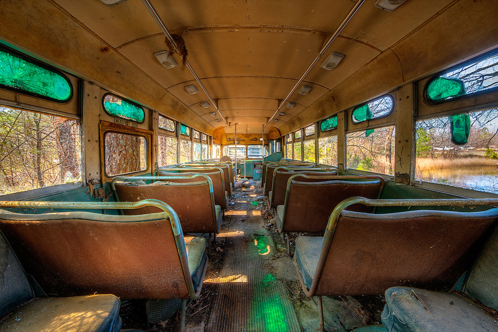An abandoned vintage school bus at the Vintage Car Graveyard in White GA. Old Car City USA