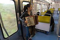Young musician in the RER B, Paris.