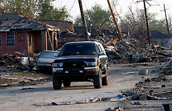 30 Sept, 2005.  New Orleans, Louisiana. Lower 9th ward. Hurricane Katrina aftermath. <br /> The remnants of the lives of ordinary folks, now covered in mud as the flood waters recede. The 4runner gets me through the streets of New Orleans.<br /> Photo; ©Charlie Varley/varleypix.com