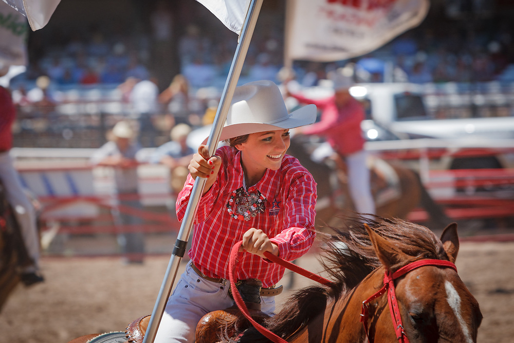 RYLEE ANDERSON of The Dandies Riding Group performs during Cheyenne Frontier Days, the world's largest outdoor rodeo.