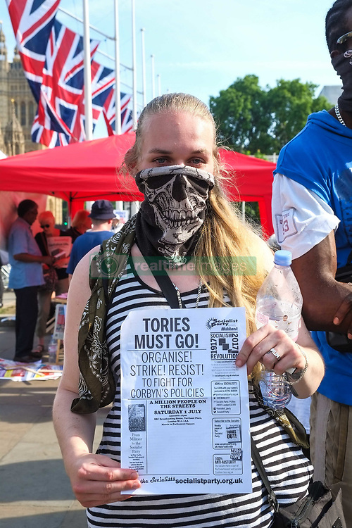 """June 21, 2017 - London, United Kingdom - Protesters march from Shepherds Bush to Parliament demanding justice for the victims of the Grenfell Tower fire and Theresa Mays resignation. The protest was organised by a Marxist group called Movement for Justice By Any Means Necessary, aims to """"shut down London"""" on the day of the Queen's speech at Parliament. (Credit Image: © Claire Doherty/Pacific Press via ZUMA Wire)"""