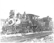 """RGS 2-8-0 #12 with short caboose #040x at Telluride.<br /> RGS  Telluride, CO  ca. 1910<br /> In book """"RGS Story, The Vol II: Telluride, Pandora and the Mines Above"""" page 96<br /> Also in """"Silver San Juan"""", p. 593.<br /> See RD 155-023 for original print."""