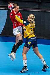 Mie Enggrob Hojlund of Denmark, Emma Lindqvist of Sweden in action during the Women's EHF Euro 2020 match between Denmark and Sweden at Jyske Bank BOXEN on december 11, 2020 in Kolding, Denmark (Photo by RHF Agency/Ronald Hoogendoorn)