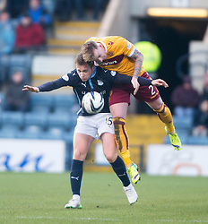 Dundee's Greg Stewart and Motherwell's Craig Reid. <br /> Dundee 4 v 1 Motherwell, SPFL Premiership played 10/1/2015 at Dundee's home ground Dens Park.