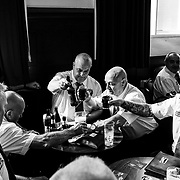 Apprentice Boys share drinks and laughter after a parade at their Londonderry meeting hall. Northern Ireland September 2019