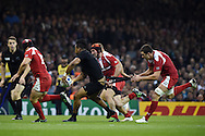 Julian Savea of New Zealand  has his shorts pulled by Shalva Sutiashvili of Georgia. Rugby World Cup 2015 pool c match, New Zealand v Georgia at the Millennium Stadium in Cardiff, South Wales  on Friday 2nd October 2015.<br /> pic by  Andrew Orchard, Andrew Orchard sports photography.