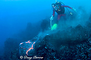 diver Bud Turpin and erupting pillow lava at ocean entry of Kilauea Volcano Hawaii Island ( the Big Island ) Hawaii U.S.A. ( Central Pacific Ocean ) MR 381