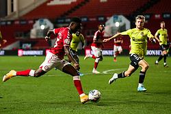 Steven Sessegnon of Bristol City is challenged by Morgan Roberts of Northampton Town - Rogan/JMP - 16/09/2020 - Ashton Gate Stadium - Bristol, England - Bristol City v Northampton Town - Carabao Cup Second Round.