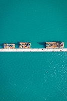 Aerial view of floating platforms in the sea.