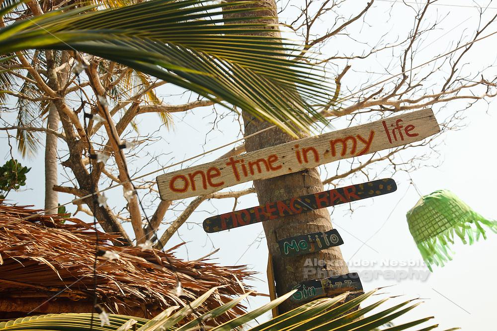 Exuberant sign decorates a tropical bar in Koh Lanta Thailand