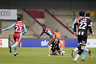 Scunthorpe United Jordan Clarke (2) commits a foul on Grimsby Town James Hanson (9) during the EFL Sky Bet League 2 match between Scunthorpe United and Grimsby Town FC at the Sands Venue Stadium, Scunthorpe, England on 23 January 2021.