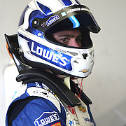 Jimmie Johnson gets ready to enter his car in the garage area during the 56th Annual NASCAR Daytona 500 practice session at Daytona International Speedway on Saturday, February 22, 2014 in Daytona Beach, Florida.  (AP Photo/Alex Menendez)