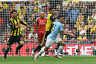 Gabriel Jesus (33) of Manchester City battles for possession with Troy Deeney (9) of Watford during the The FA Cup Final match between Manchester City and Watford at Wembley Stadium, London, England on 18 May 2019.