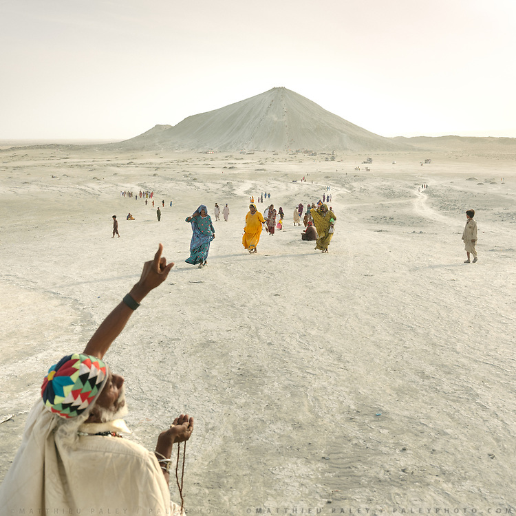 "Pilgrims arriving at one of the volcano. The area around Chandragup (meaning ""Moon Well""), a sacred site to Hindu of 3 mud volcanoes (mainland Asia's largest ones)."