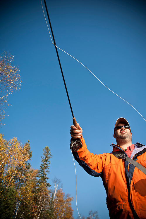 Fall fly fishing for trout along the Escanaba River in Michigan's Upper Peninsula.