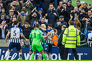 Aaron Mooy (Brighton) celebrates his goal with Alireza Jahanbakhsh (Brighton) with Mathew Ryan (GK) (Brighton) & Lewis Dunk (Capt) (Brighton) waiting to congratulate him during the Premier League match between Brighton and Hove Albion and Bournemouth at the American Express Community Stadium, Brighton and Hove, England on 28 December 2019.