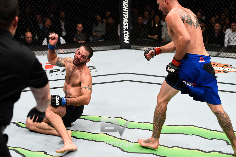 TORONTO, CANADA - DECEMBER 10:  (L-R) Donald Cerrone knocks out Matt Brown with a kick to the head in their welterweight bout during the UFC 206 event inside the Air Canada Centre on December 10, 2016 in Toronto, Ontario, Canada. (Photo by Jeff Bottari/Zuffa LLC/Zuffa LLC via Getty Images)