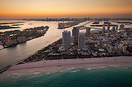 Aerial of Miami Beach, South Point and the entrance to  Government Cut and the Port of Miami at twilight