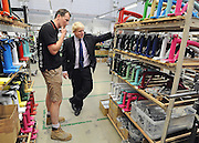 © licensed to London News Pictures. LONDON, UK.  02/06/11. Boris Johnson (R)is shown the manufacturing process at Brompton Bicycles in West London by its CEO Will Butler-Adams (L). The Mayor of London Boris Johnson visits two major manufacturing firms today, 02 June 2011, to see the role they play in supporting London's economy and why the UK's capital city  is so critical to their continued success. He called in to Fuller's in Chiswick, London's only traditional family brewery, to see their new multi-million pound brewing facility. He went on to visit Brompton bike factory. Where he met Brompton inventor Andrew Ritchie, who still owns the famous company and remains its Technical Director.  Photo credit should read Stephen Simpson/LNP