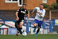 Michael Jacobs of Wigan Athletic looks to get away from Chris Hussey of Bury. Skybet football league one match , Bury v Wigan Athletic at the JD Stadium in Bury, Lancs on Saturday 10th October 2015.<br /> pic by Chris Stading, Andrew Orchard sports photography.