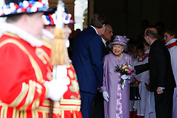 Queen Elizabeth II and the Duke of Edinburgh leave following Evensong in celebration of the centenary of the Order of the Companions of Honour at the Chapel Royal Hampton Court Palace in southwest London.