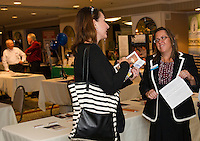 Tina Kasim from the Division of Economic Development and Karmen Gifford Executive Director Laconia Chamber of Commerce talk during the Lakes Region Business Resource Fair at the Margate on Wednesday morning.  (Karen Bobotas/for the Laconia Daily Sun)