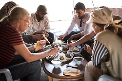 6 October 2018, Jordan Valley, West Bank, Occupied Palestinian Territories: A simple meal closes the visit of the EAs to the community this particular day, as a gesture of hospitality, and a sign of appreciation for the presence and protection they provide to the community. Ecumenical Accompaniers from the World Council of Churches Ecumenical Accompaniment Programme in Palestine in Israel accompany shepherds in many parts of the West Bank, providing an international presence known to have a mitigating effect on confrontations between Israeli settlers and the Palestinians. EAs' presence also helps Palestinians access lands they otherwise might not have dared to continue to cultivate. In the West Bank's Area C, any land that isn't cultivated for a period of three years becomes property of the state, the shepherds explain, so accessing their lands regularly is vital for the communities and their herds.