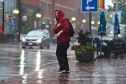 A man walks in the rain on Main street in Moncton, N.B. as a result of hurricane Dorian as a result of hurricane Dorian pounding the Atlantic Provinces with heavy rain and winds on Saturday September 7, 2019, Canada. Photo by Marc Grandmaison/CP/ABACAPRESS.COM