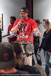 Custom builder Jesse Srpan of Raw Iron Choppers talks about his Evo custom on display in the Old Iron - Young Blood exhibition during the media and industry reception in the Motorcycles as Art gallery at the Buffalo Chip during the annual Sturgis Black Hills Motorcycle Rally. Sturgis, SD. USA. Sunday August 6, 2017. Photography ©2017 Michael Lichter.