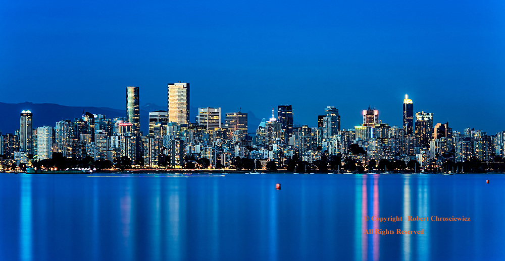 Downtown at dusk, this long exposure captures the blue hour sky and the oceans reflection, Vancouver British Columbia Canada.