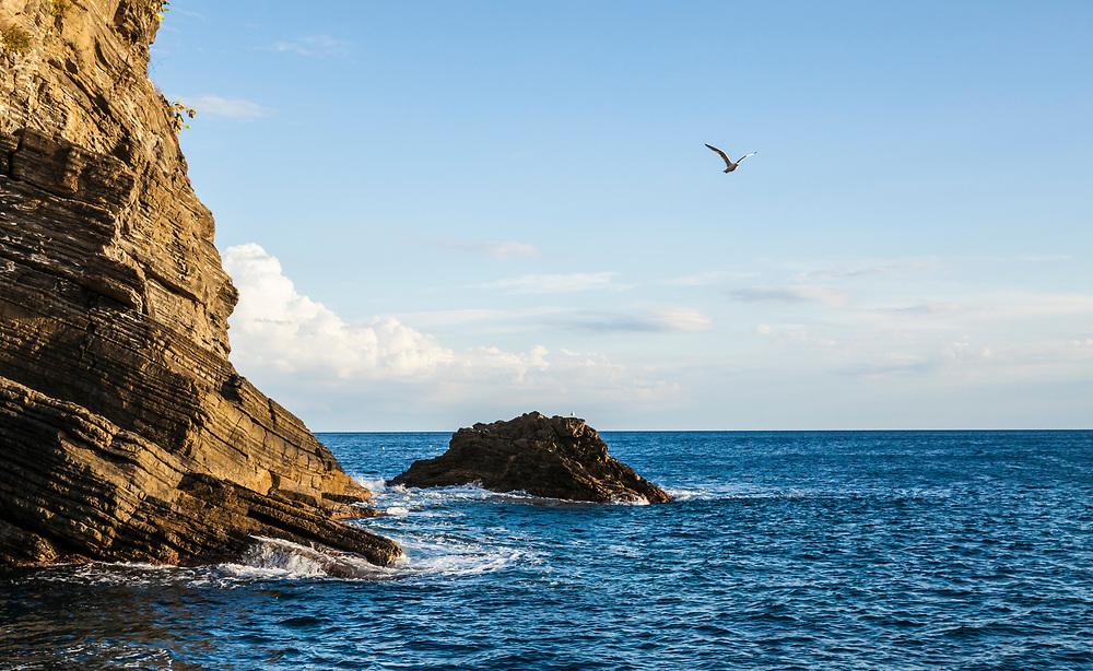 The rocky coast of the Cinque Terre Riviera along the Ligurian Sea, Italy.