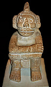 Stone seated figure of Xochipilli, AD 1325-1521 from Mexico. Aztec Xochipilli was the Mexica god of music and dance. His name in Nahuatl, the language spoken by the Mexica, means 'Flower Prince'. He was also called Macuilxochitl. Music and dance played an important role in Mexica religious and public ceremonies.
