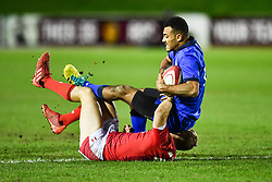 Michael Mba of Italy is tackled by Sam Costelow of Wales <br /> <br /> Photographer Craig Thomas/Replay Images<br /> <br /> U20 Six Nations - Wales v Italy  - Friday 31st January 2020 - Stadiwm Zip World (Parc Eirias) - Colwyn Bay<br /> <br /> World Copyright © Replay Images . All rights reserved. info@replayimages.co.uk - http://replayimages.co.uk