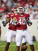 Sep 10, 2011; Little Rock, AR, USA; Arkansas Razorback linebacker Joe Bequette (40) reacts to scoring a touchdown during the first half of a game against the New Mexico Lobos at War Memorial Stadium.  Mandatory Credit: Beth Hall-US PRESSWIRE