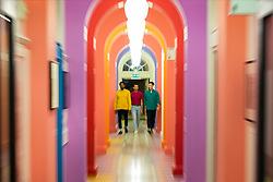 © Licensed to London News Pictures. 11/06/2019. London, UK. Visitors walk through the colourful Yinka Ilori designed space at the 'Get Up, Stand Up Now: Generations of Black Creative Pioneers' exhibition at Somerset House, London. This major new exhibition celebrates the past 50 years of Black creativity in Britain and beyond. Beginning with the radical Black filmmaker Horace Ové and his dynamic circle of Windrush generation creative peers and extending to today's brilliant young Black talent globally, a group of around 100 interdisciplinary artists are showcasing their work together for the first time, exploring Black experience and influence, from the post-war era to the present day. The exhibition opens on June 12, 2019 and runs until September 15, 2019.  Photo credit: Peter Macdiarmid/LNP