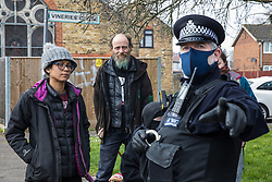 Sipson, UK. 8th March, 2021. A Metropolitan Police officer takes part in an operation to evict residents from the remaining section of a squatted off-grid eco-community garden known as Grow Heathrow. Grow Heathrow was founded in 2010 on a previously derelict site close to Heathrow airport in protest against government plans for a third runway and has since made a significant educational and spiritual contribution to life in the Heathrow villages which are threatened by airport expansion.