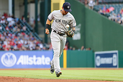 May 22, 2018 - Arlington, TX, U.S. - ARLINGTON, TX - MAY 22: New York Yankees left fielder Giancarlo Stanton (27) juggles the baseball back to the dugout during the game between the Texas Rangers and the New York Yankees on May 22, 2018 at Globe Life Park in Arlington, Texas. The Rangers defeat the Yankees 6-4. (Photo by Matthew Pearce/Icon Sportswire) (Credit Image: © Matthew Pearce/Icon SMI via ZUMA Press)
