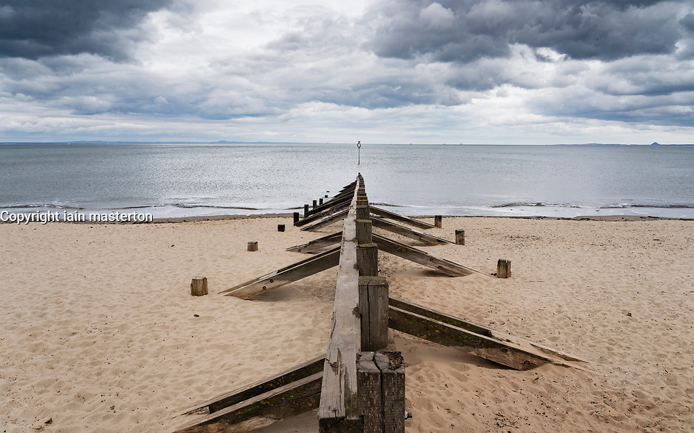 Wooden groyne on Portobello beach , Scotland, UK