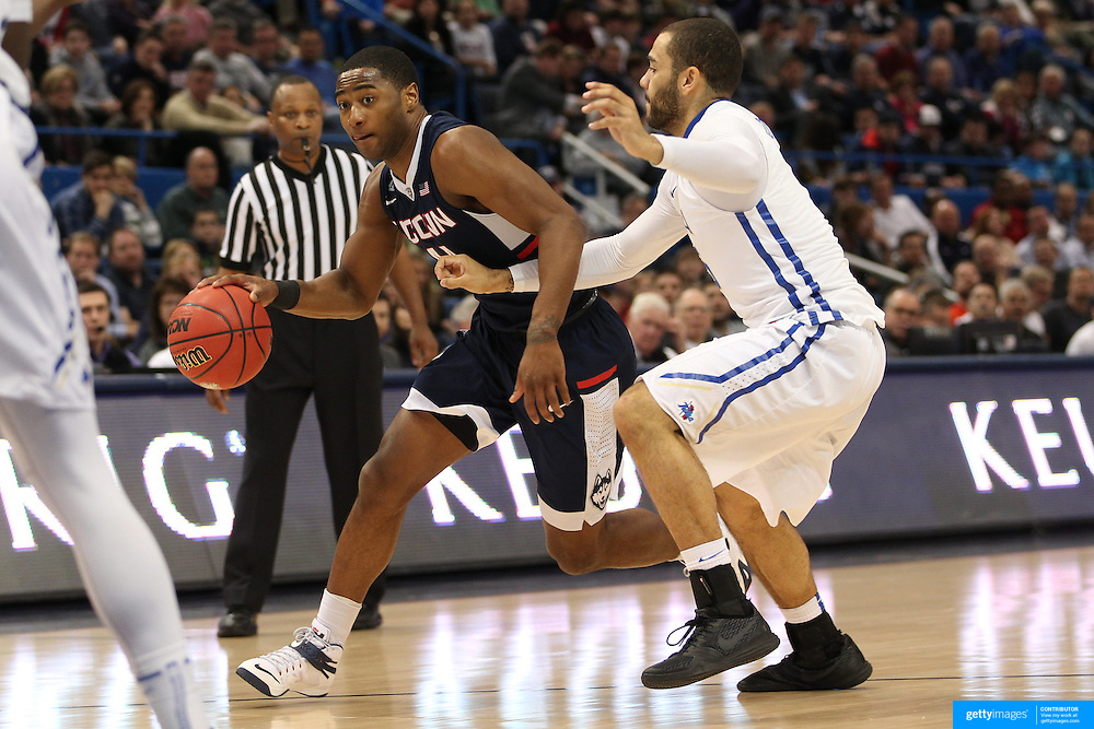 Rodney Purvis, (left), UConn, drives past Marquel Curtis, Tulsa, during the UConn Huskies Vs Tulsa Semi Final game at the American Athletic Conference Men's College Basketball Championships 2015 at the XL Center, Hartford, Connecticut, USA. 14th March 2015. Photo Tim Clayton