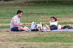 © Licensed to London News Pictures. 08/09/2020. London, UK. After the wind and rain, picnickers on Wimbledon Common enjoy some warm weather as a mini heatwave for September hits the South East this week with temperatures predicted to reach up to 24c today. Photo credit: Alex Lentati/LNP