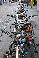 A jumble of bicycles parked in Temple Bar in Dublin Ireland