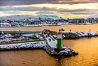 A lighthouse in the harbor at Bodo, Arctic, Northern Norway.